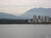View from Kits Beach looking across English Bay to Stanley Park in Vancouver